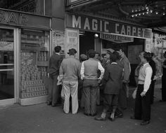 Tense photos capture the atmosphere as New Yorkers wait for news on D-Day