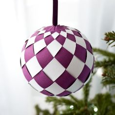 Using paper and glue create these fabulous baubles for your Christmas tree.