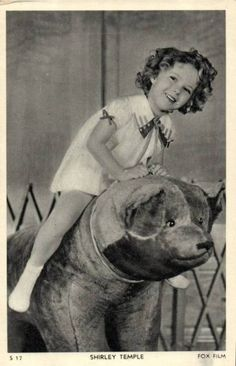 Shirley Temple with a toy bear, 1930s