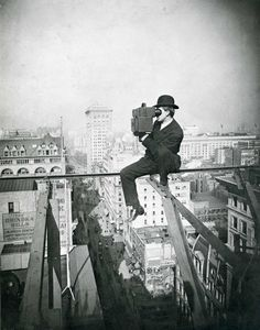 Charles C. Ebbets takes a photo from atop a skyscraper in New York City, 1905.