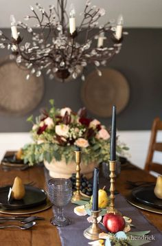 This moody fall tablescape is inspired by an oil still life painting and features different harvest fruits and a bounty of flowers. #Fall #FallTablescape #FallDecor