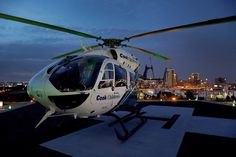 Fort Worth's cook chrildren's hospital air ambulance helicopter with part of downtown Fort Worth skyline in background !!