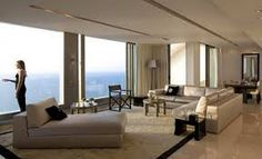 Modern Luxury Living Area With Beige Comfy Sofa Bed And Sea Views Also Beige Fur Rug And Furnishings By Armani Casa Design Ideas: Luxury Beachside Opera Penthouse with Armani Casa Decoration