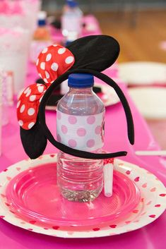 Place settings at a Minnie Mouse birthday party! See more party ideas at CatchMyParty.com!