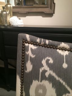 Want a piece of sophisticated furniture with a bold pattern with beautiful nail head trim to finish it off? Come by our showroom to see what fabrics and finishes you can mix and match together to create the look you want  #HPM14