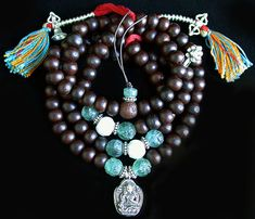 Tibetan Mala with fluorite and jade carved beads