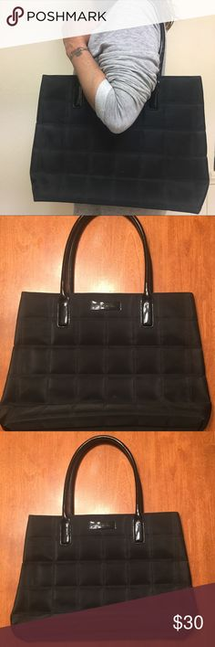 """GIVENCHY Black Quilted Weekender Tote Bag Black Quilted Weekender Tote Bag by Givenchy Parfums  Color – Black with Pink Fuschia Lining   Measures: 12.00"""" Tall and 16.50"""" Long and 4.25"""" Deep ** Handle 8.00"""" Wide – Handle Drop 8.25""""  A vintage tote handbag in quilted black polyester with a fuschia pink lining.  The interior is clean and has a cellphone pocket and a zippered pocket.  Exterior has an upscale quilted design with slight fraying on handle. Plenty of room for weekends, beach, pool…"""