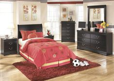 "Enhance the style of any bedroom with the rich traditional beauty of the ""Huey Vineyard"" bedroom collection."