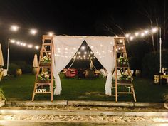 Ladder backdrop!  Another great way to decorate our ladder arbour. This was from a wedding we styled at Goldings Winery, used to walk through from the ceremony to reception. Curtains and crystals draped in the opening and wooden sewing machine boxes with flowers on the steps.