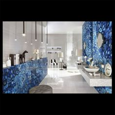 SEMI-PRECIOUS | BLUE AGATEThe next generation of Semi-precious slabs and tile:  Blue Agate's attraction goes beyond its visual beauty.  It adds warmth and style to any home or office. This semiprecious stone is also believed to have powerful, protective and healing properties. #MOTW #MarbleOfTheWorld