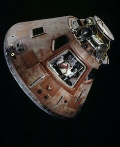 "July 24, 1969: Apollo 11 command module ""Columbia"" splashes down in the Pacific Ocean, returning astronauts Neil Armstrong, Buzz Aldrin and Michael Collins safely back to Earth.  The spacecraft is on display in the ""Milestones of Flight"" gallery at the National Air and Space Museum in Washington, DC."