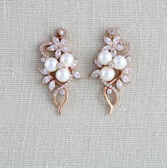 These lovely earrings I created using Swarovski Pure Brilliance cubic zirconia flower components and faux pearls. Beautiful rose gold finish. Earrings dangle 1-1/2 inch and are 3/4 inch at their widest. Gorgeous sparkle ! READY TO SHIP MATCHING PIECES: