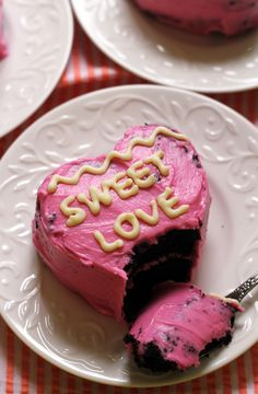 Conversation heart cakes made from a decadent black velvet cake and covered in classic vanilla cream cheese frosting