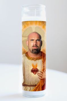 """Goldberg  Saint Goldberg featured on Illuminidol's Texas-made 8"""" prayer candle. The most divine way to bless any Goldberg disciple!  Texas Made 8"""" in height Unscented Ships anywhere in the US via Priority Mail International Shipping? Please contact info@illuminidol.com Custom and Wholesale options available  #goldberg #wrestler #wrestling #wrestlemania #wwe #sports #popular #famous #celebrities #pray #candles #art #beautiful #memes #blessed #lit #fire #funny #lol #austin #texas #local…"""
