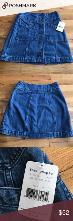 NWT Free People Denim Skirt NWT jean skirt. Zipper and buttons down front as well as pockets. Free People Skirts
