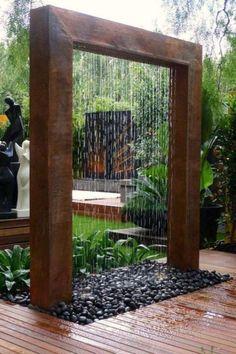 amenagement-jardin-moderne-cascade-galets-plantes aménagement jardin moderne
