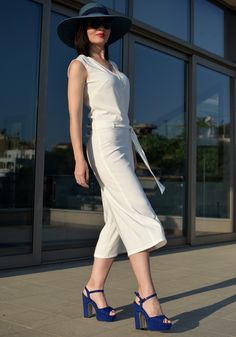 Minimalist style white zip culotte wrap front jumpsuit, up to the middle of the calf. Explore all women's jumpsuit from our new spring-summer collection Sport Chic, Fashion Seasons, Belt Tying, Spring Summer 2018, Print Patterns, Sequins, Jumpsuit, Dresses For Work, Zip