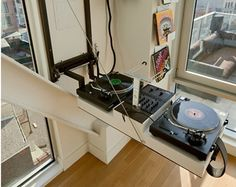 We've always been fond of musicians' homes; where in our mind, it would be nothing less than the ultimate entertaining spaces for guests. Luckily, for those who can't afford to fit an entire band in their space, they can substitute by building in a custom hide-away DJ turntable island that'll be sure to impress.