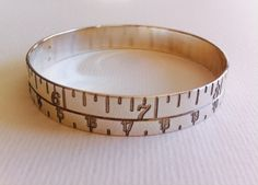 narrow tape measure bangle stg silver made by Joanna Campbell