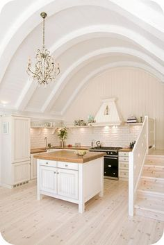 White-Washed Kitchen with Barrel Ceiling