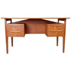 Gunnar Tibergaard teak desk, Danish, 1960s | From a unique collection of antique and modern desks and writing tables at https://www.1stdibs.com/furniture/tables/desks-writing-tables/