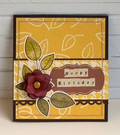 Die-cut images on birthday card. Stamped and heat-embossed background