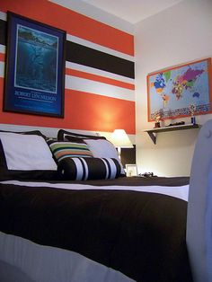 Sherwin Williams Obstinate Orange and Behr Swan White stripes in boys bedroom | Involving Color Paint Color Blog