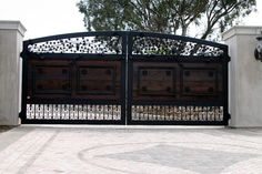 A wood & iron gate. Located in Murrieta, CA. Designed, built and installed by Rising Star Industries. We are southern Californias leading automatic gate installers. Automatic gates in southern California. Driveway gates, security gates, electric gates, wrought iron gates, property security, swing gates, slide gates & vertical lift gates. We also do masonry columns, custom wrought iron front doors and window coverings. www.rsigate.com or www.risingstarindustries.com