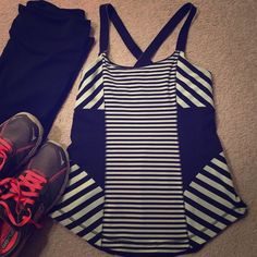 lululemon tank Eye-catching striped top (mint green & black) by lululemon athletica. Sweat wicking technology & built in bra. Built in pockets for optional removable bra cups (not included). Cross straps in back. In excellent used condition. Size 8. lululemon athletica Tops Tank Tops