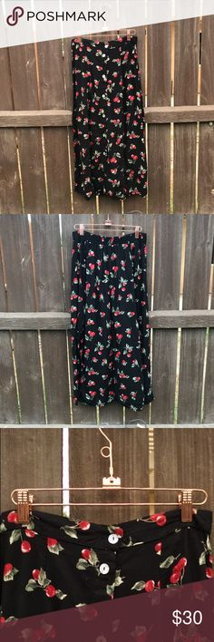 Vintage black midi skirt with cherries Vintage black midi skirt with cherries 🍒  This vintage skirt is such a rare gem, these would be perfect to pair some cherry earrings. This shirt would go great with a black tube top and some mules!  Prefect for summer  Tag says size large Vintage Skirts Midi