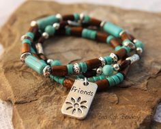 Friendship Beaded Stretch Stack Bracelet - Blue Turquoise Heishi and Wood Beads Charms. $29.25, via Etsy.