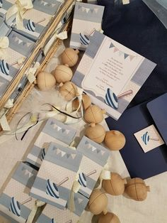 Christening invitation & bomboniere with spinning top in navy blue. Made by Prototypon, Athens.