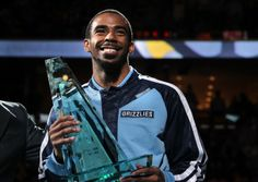 Photo: April 24, 2014 - Memphis Grizzlies guard Mike Conley (11) holds his Sportmanship award presented before the game. Memphis Grizzlies guard Mike Conley has been named the winner of the NBA Sportsmanship Award. What an amazing accomplishment.The trophy is named after former Detroit Pistons star Joe Dumars, the initial winner in 1995-96, and is given to a player who reflects the ideals of sportsmanship -- ethical behavior, fair play and integrity -- in amateur and professional…