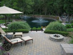 A natural depression by the treeline was the perfect place to locate a large pond in this backyard. Several trips to Disney World inspired the design of the water feature, which serves as the backdrop for the patio.Shared by HGTV fan theofiles