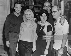 Cast and crew on the set of 'The Fugitive Kind', New York, USA, 1959. Left to right: Marlon Brando (1924 - 2004), Joanne Woodward, Anna Magnani (1908 - 1973), director Sidney Lumet (1924 - 2011), and cinematographer Boris Kaufman (1897 - 1980).