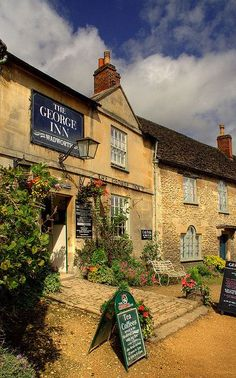 England Travel Inspiration - The George Inn, Lacock, Wiltshire, England.  Lacock is owned by the National Trust - including the shops, cafes and pubs.  It is often used as a film location for period film & TV productions.