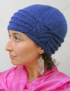 Free Rosazura Cloche Hat Knitting Pattern -  This cloche by Alegria DaSilva features Art Deco detail in  garter stitch bands radiating from a framed staghorn cable. Rosazura was created using Berroco Lustra, which provides a subtle sheen and excellent stitch definition.
