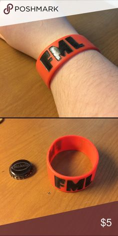 'FML' Band Bracelet This will fit nearly any wrist and is an orangey red color. Hot Topic Jewelry Bracelets