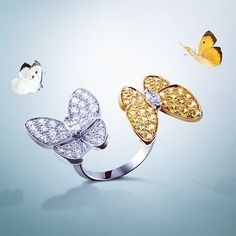 Van Cleef & Arpels Two Butterfly Between the Finger Ring set in white and yellow gold, diamonds, yellow sapphires
