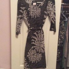 It B DARLIN ❤️. Sweater dress Gray black muted silver colors on belted sweater dress.  Very nice. Never worn. Abstract floral swirl pattern. Hits at knee. B Darlin Dresses Midi