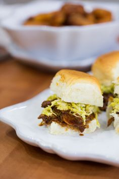 This easy recipe for slow-cooker pulled pork slider with Brussels sprouts slaw is a great idea if you're entertaining.