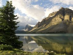 A clearing storm reflects off of Bow Lake Banff National Park Alberta Canada.