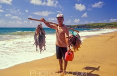 Fisherman with Fish on Beach | PhotosPR.com