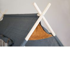 The Field Tent is part of the Wilderness Collection, a collaboration between Kalon Studios and Nico Nico. Pairs with the Backcountry Stool. Canvas, leather and wood play tent for kids sustainably made in the USA.