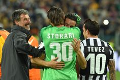 Marco Storari and Simone Padoin of Juventus celebrate after beating Atalanta BC 1-0 to win the Serie A Championships at the end of the Serie...