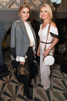 Olivia Palermo and Mariya Dykalo attend the Aspinal of London presentation during London Fashion Week September 2017 on September 18 2017 in London...