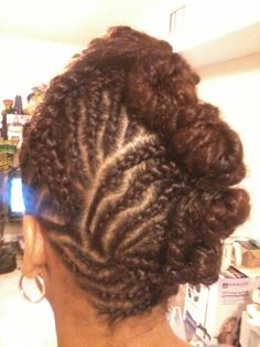 Braids into a twisted/ rolled bun. Done on all natural hair but can be done if hair is permed. Styled by Sheba Ma