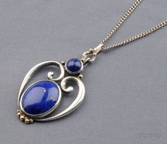 Arts & Crafts Sterling Silver, 14kt Gold, and Lapis Pendant, Margaret Rogers, c. 1919, set with two cabochons, scrolling mount, applied gold bead accents, pendant signed, suspended from the original silver chain with original signed clasp, lg. 18 1/2 and 1 3/4 in.