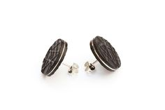 Richly textured stud earrings, handmade from sterling silver and embossed leather. These round stud earrings are from the 'Skin' collection which is inspired by individuality. The embossed patterns are abstracted from skin textures seen on a micro.