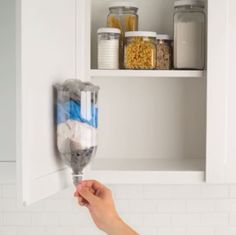Cut the bottom off of a 2-liter soda bottle and mount it to create a plastic bag dispenser #Lowesfixinsix